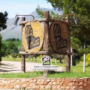 Cartel de acceso a Villa Ventana